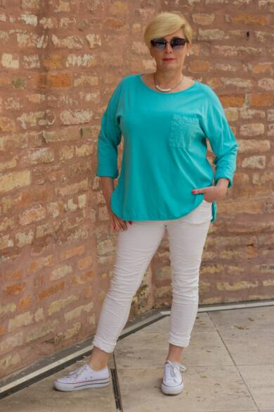 Fehér színű, gumírozott derekú rugalmas pamut-vászon nadrág