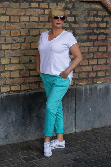 Zöld színű, gumírozott derekú rugalmas pamut-vászon nadrág