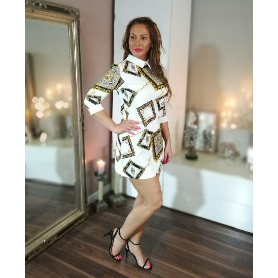 7801b9507 Fehér, fekete, arany, tigris mintás, fehér galléros harang szabású ruha.